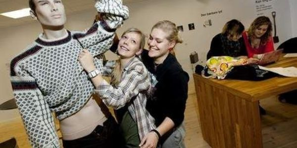At Struer Museum, students from Struer Statsgymnasium dress a shop dummy in preparation for the opening of their exhibit about the youth revolution in Struer.